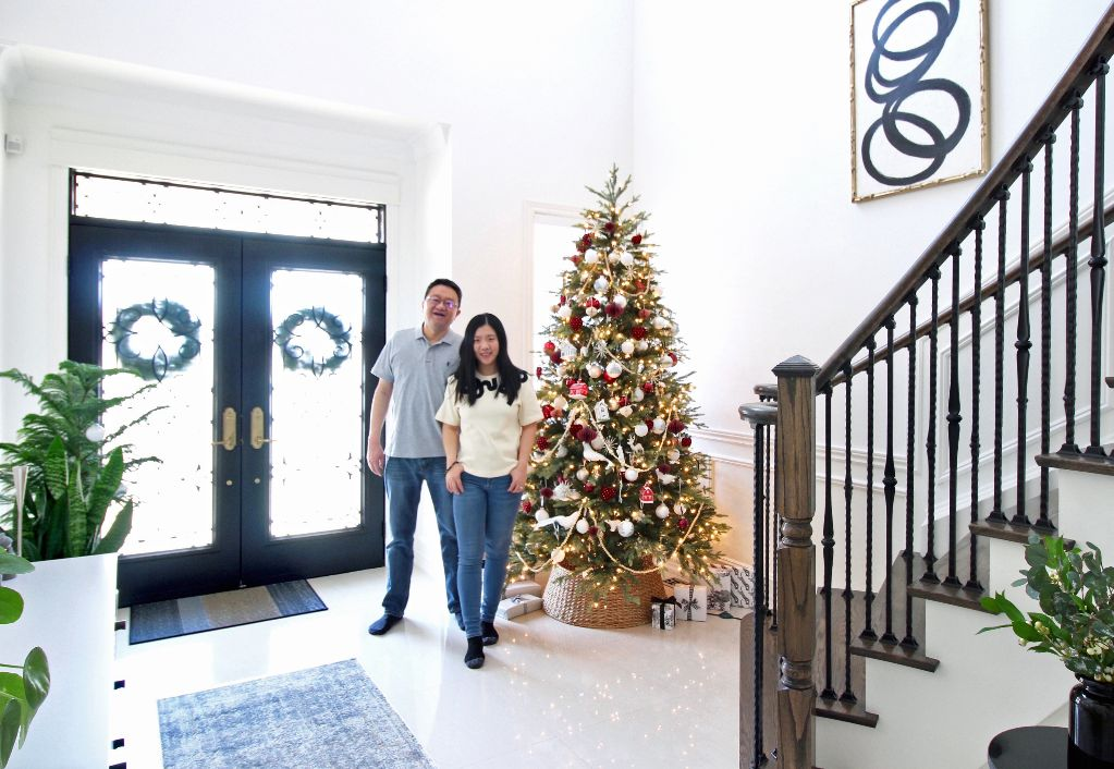 Anthony and Michelle at home foyer during Christmas