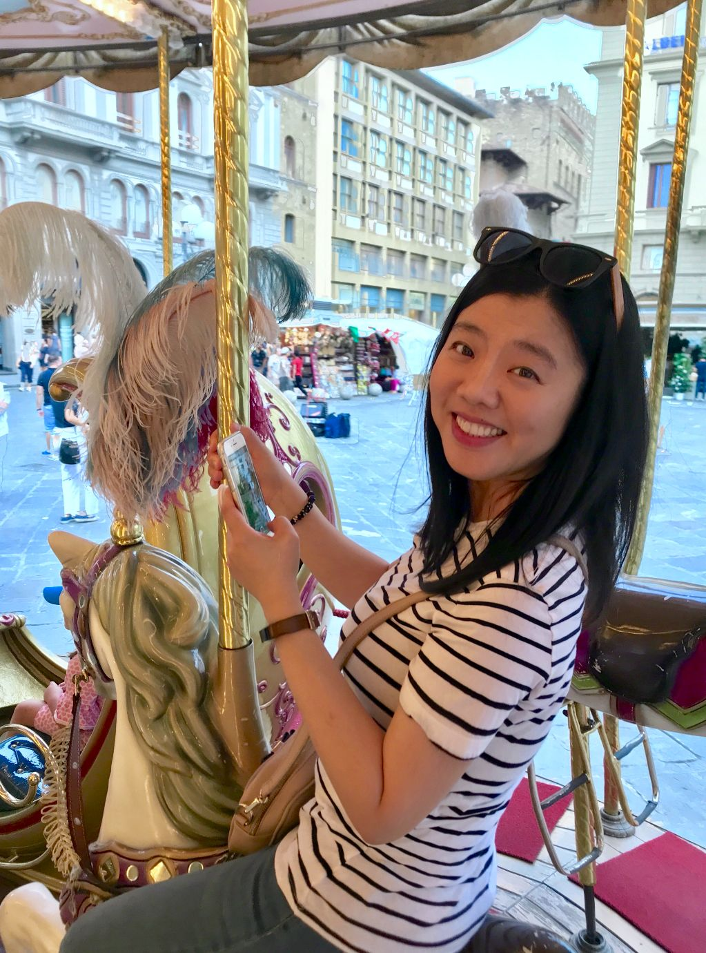 Michelle on a merry-go-round in Florence