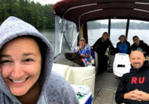Family boat trip in the rain, but we're all still smiling.