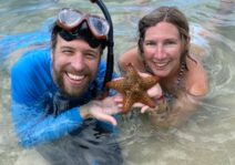 David and Kim with a starfish they found while snorkeling in Roatan; Feb 2020