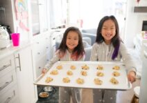Willamena and Violet baking cookies with Kim at home