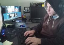 Charles gaming in his office