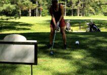 Lindsay golfing at the cottage.