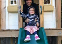 Domenic playing with our niece in grandmas playhouse