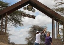 High-fiving at the entrance to the Serengeti in Tanzania where we went on our honeymoon!
