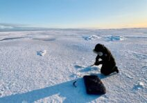 Marley ice fishing in Igloolik.