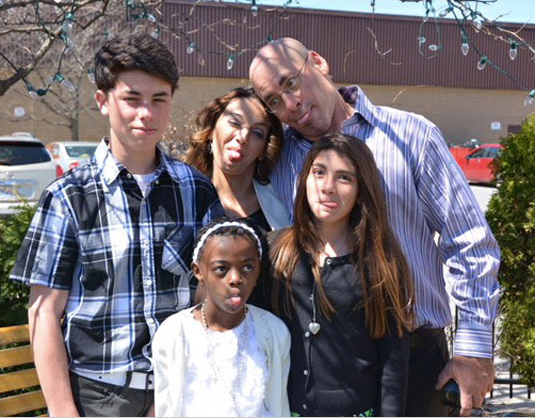 A Goofy Family Picture of Us with our Niece Adriana at her Communion. We made Christmas Ca
