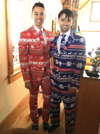 Being silly at Christmas at the cottage with our holiday suits