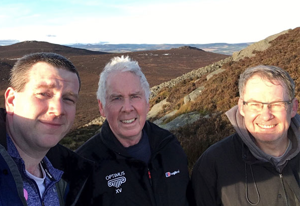 Dave, his dad and his uncle out for a windy Scottish hike.