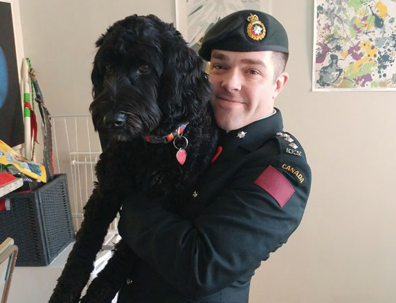 Kenneth posing with Roxie, our labradoodle, Remembrance Day 2017