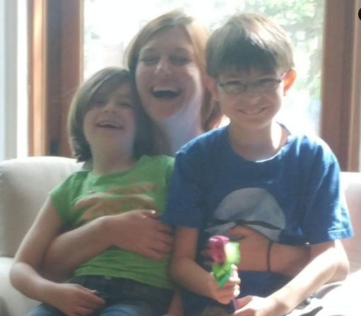 Eliza having giggles with her de facto niece and nephew, Montreal, 2018
