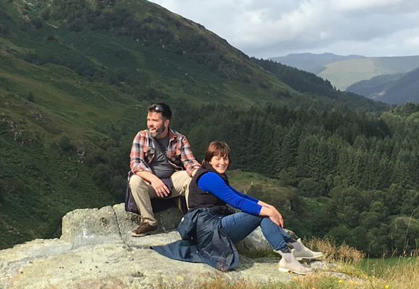 Eliza and Kenneth unphotogenically relaxing on a Scottish summit, 2019