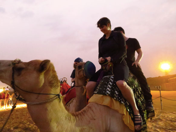 Jane and Marius riding a camel in Dubai (2014).