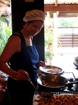 Jane taking a cooking class in Thailand (2013).