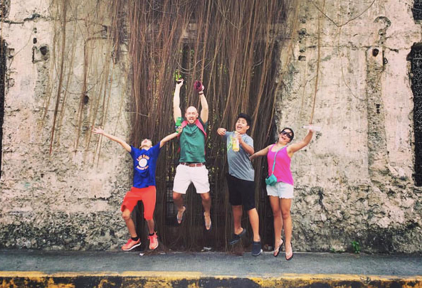 Mani and the cousins doing 'jumping shot' on a family vacation to Manilla, Philippines.