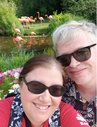 Dan and Jenn hanging out with flamingos
