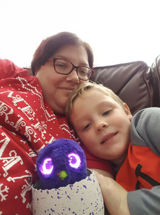 Jenn with our nephew at Christmas