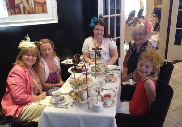 Jenn with the ladies of her family Mom, Sister, Niece and mother in law having high tea in