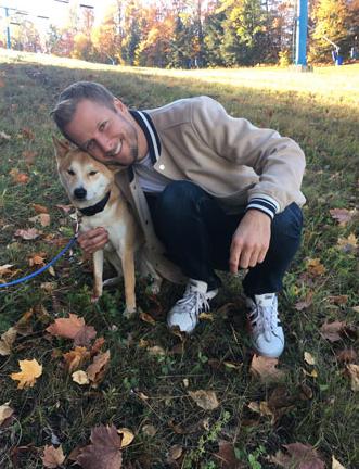 Alex with our dog, Henri.