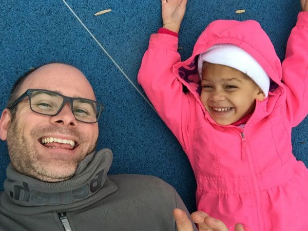 Uncle Kenny gets silly with his niece at the park.